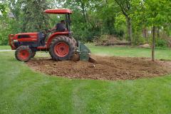 Motz-Grading-a-garden-area