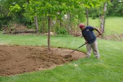 Motz-hand-raking-a-garden-area